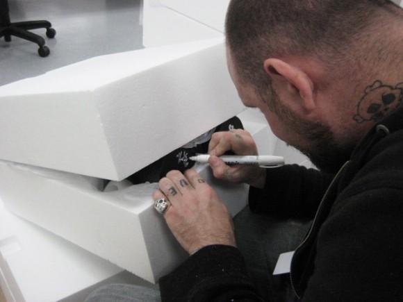 Huck Gee signs Skullhead Dunnys at the Kidrobot warehouse
