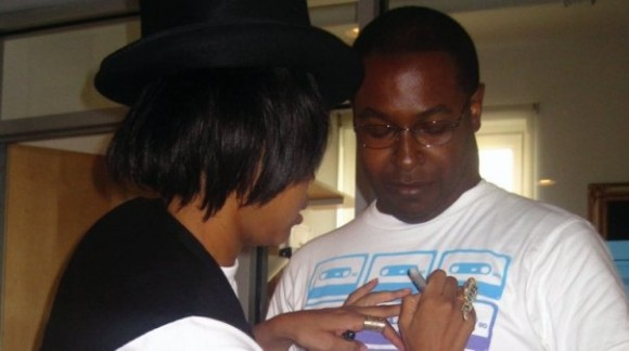 Erykah Badu signs Jay Fingers' shirt at the Kidrobot offices