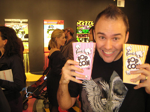 Carlos East enjoying popcorn at the D*Face exhibit at the Jonathan Levine Gallery